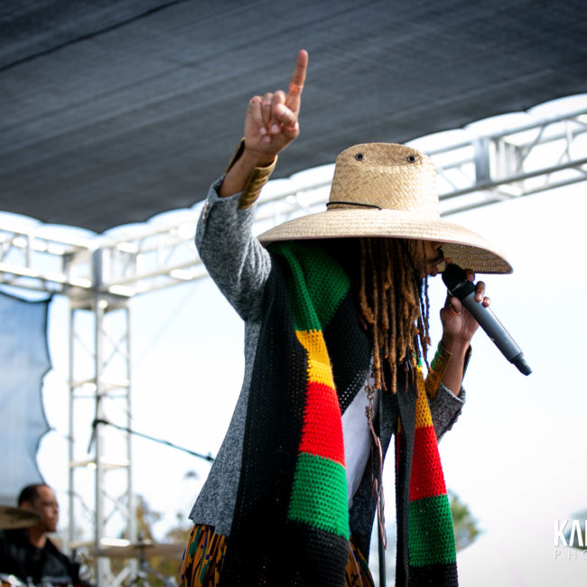 Nation Zamar with one finger in the air
